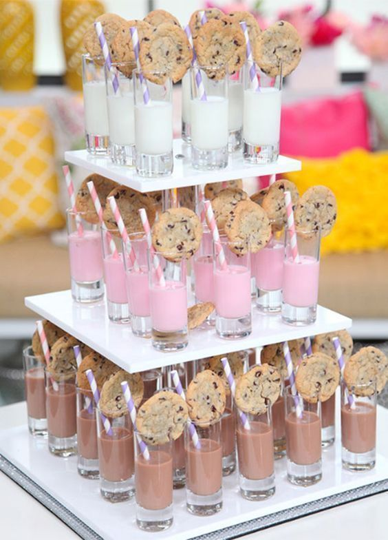 a cute strawberry and chocolate milk and cookie food bar is a cool and fun idea for a brunch wedding