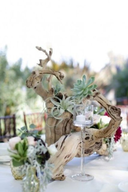 a driftwood wedding centerpiece with air plants, candles is a laconic and chic beach idea
