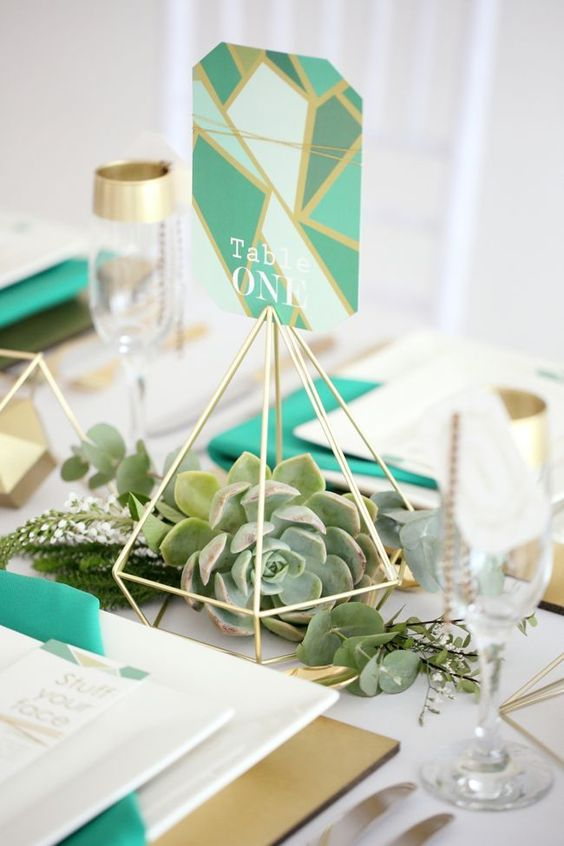 a geometric decoration with a large succulent is a great idea for a modern geometric wedding