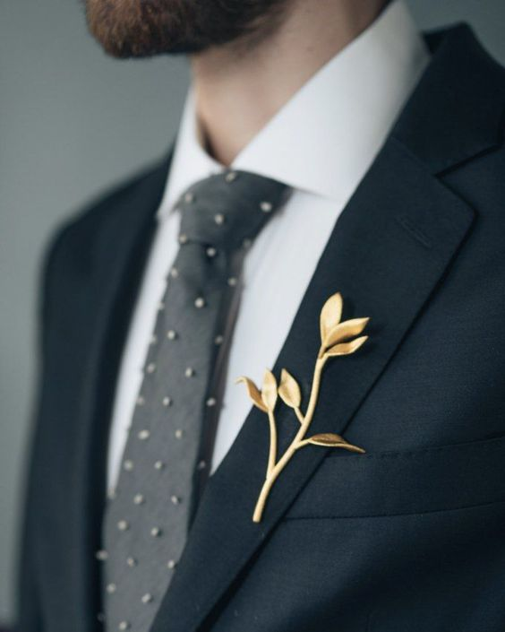 a gilded branch as a boutonniere is an elegant solution that looks out of the box and adds chic and style to the look