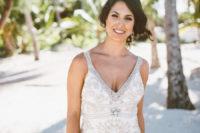a beach wedding dress with embellished neckline