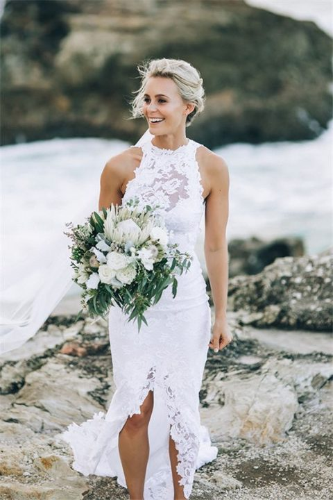 a lace illusion halter neckline wedding dress with a front slit is a very sexy and very bold idea for a boho beach bride