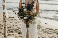 a lace sheath wedding dress with a plunging neckline and a front slit plus a gorgeous shell crown