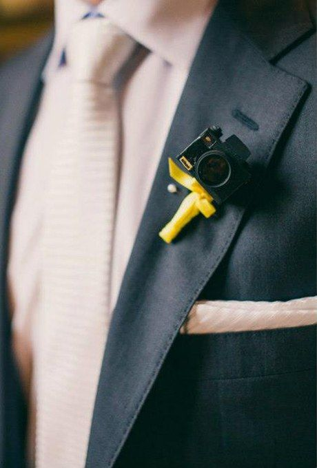 a little camera wedding boutonniere with a yellow bow is a lovely idea for a groom who is a photographer or just loves taking pics