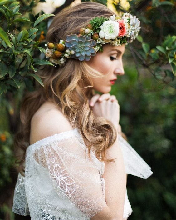 a lovely floral and succulent crown with billy balls is a cool accessory for a boho bride