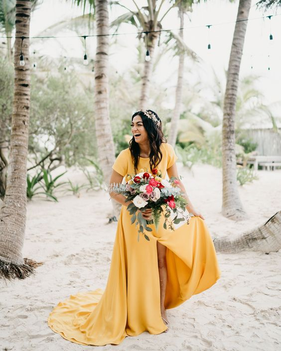 a marigold wedding dress with a high neckline, short sleeves, a front slit and a train to add color to your look