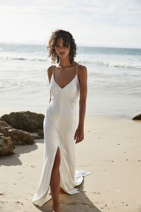 a modern slip wedding dress with a front slit is a super comfy and classic option for a beach