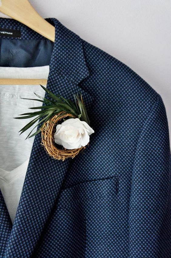 a nest boutonniere with a white rose and greenery is a stylish idea to rock at a spring or Easter wedding