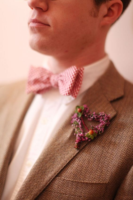 a pretty heart-shaped floral boutonniere with berries is a lovely idea to add a romantic touch to the look