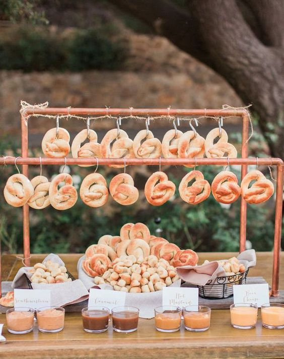 a pretzel bar with various kinds of dips is a trendy idea for any wedding