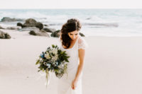 a romantic sheath lace wedding dress with cap sleeves and a flattering neckline and a small train