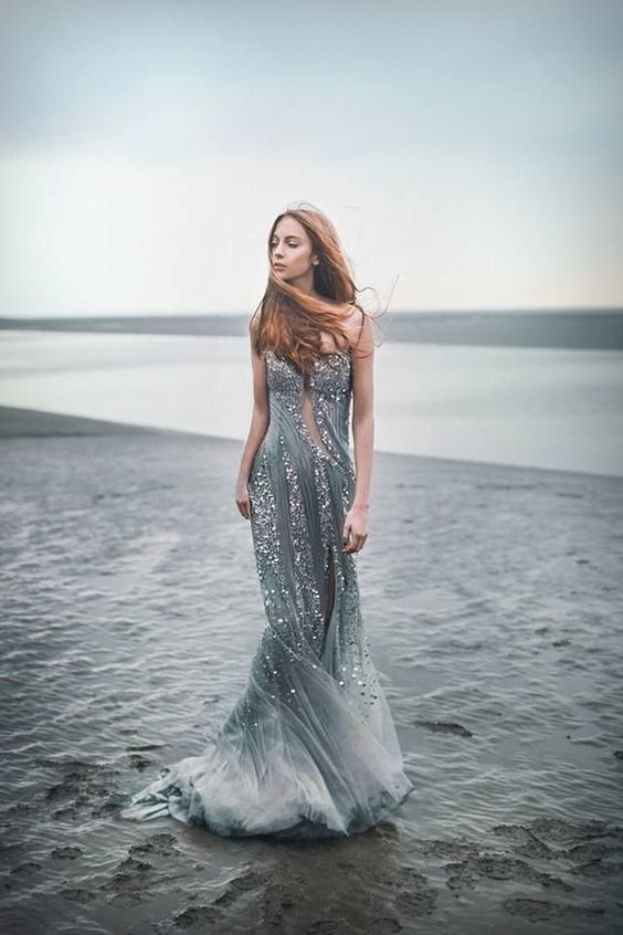 a unique mermaid-inspired wedding gown in grey, with embellishments and a train is a fantastic idea