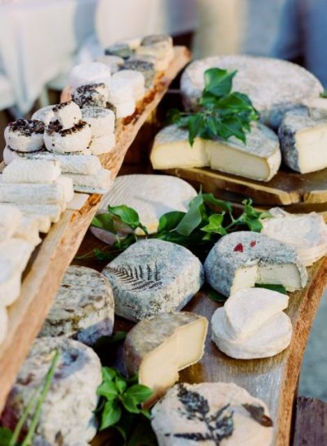 a wedding cheese bar with various kinds of cheese can substitute any wedding sweets table if you don't like sweets