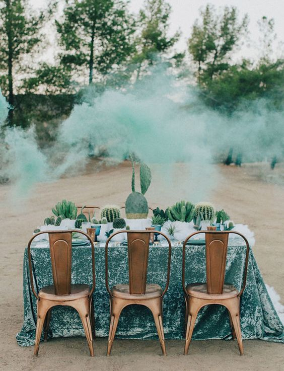 a wedding table runner composed of potted cacti and succulents is a lovely eco-friendly idea for a desert wedding