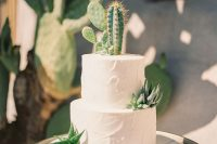 a white textural wedding cake topped with cacti and succulents is a cool idea for a desert wedding
