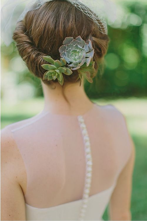 accent your wedding updo with a couple of chic succulents to make your look wow