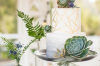 an ombre and geometric wedding cake with succulents and thistles is very chic and trendy