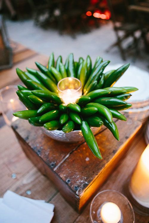 an unusual and bold wedding centerpiece with a hammered bowl, peepers and a candle in a candle holder