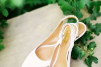 chic white wedding slingbacks with embellished backs are very trendy and will be perfect for a modern or minimalist bride
