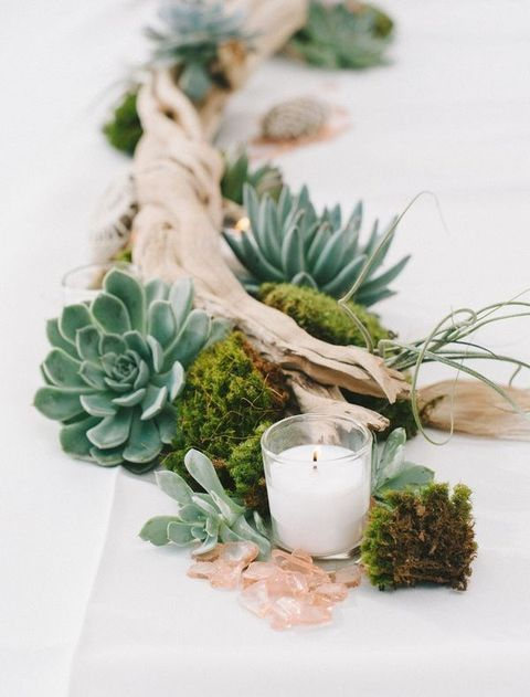 driftwood, moss, candles and succulents and air plants for a beach or seaside wedding