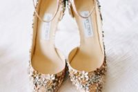 gold glitter wedding shoes with metallic flowers and ankle straps for a floral-filled wedding