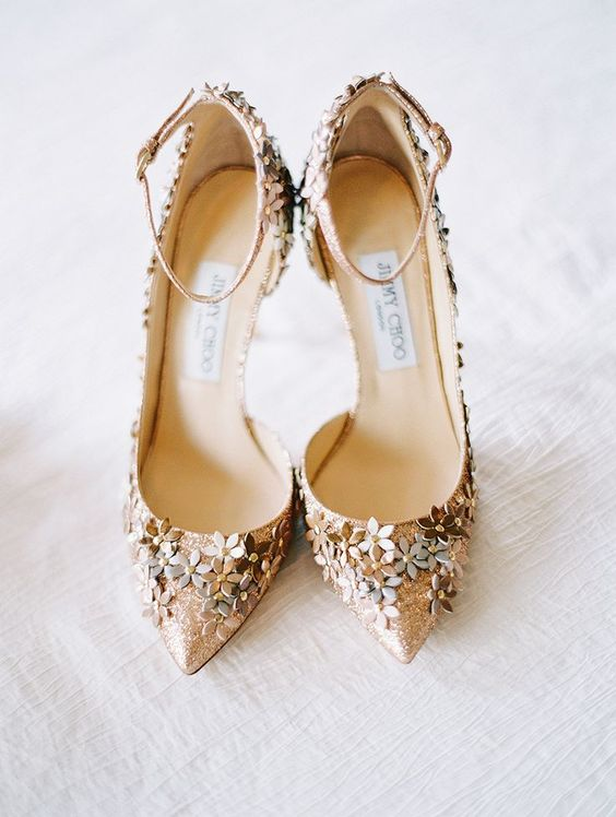 gold glitter wedding shoes with metallic flowers and ankle straps for a floral filled wedding