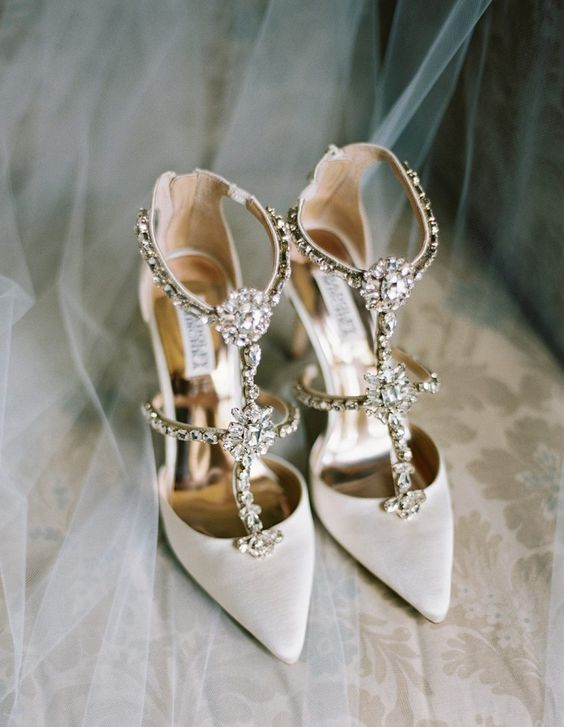 gorgeous glam white wedding shoes with fully embellished straps and heavy embellishments are a bold solution for summer