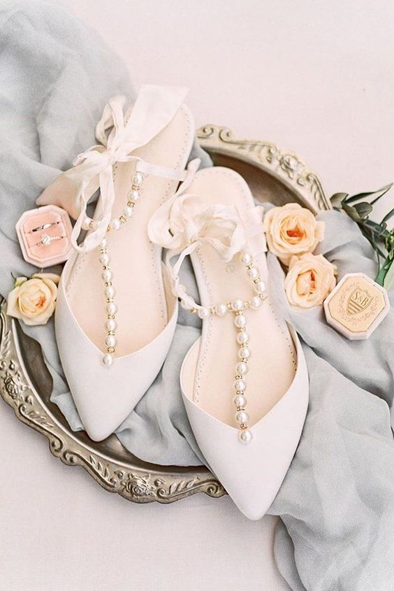 gorgeous white wedding shoes with silk ribbon straps and large pearls for a touch of glam and chic