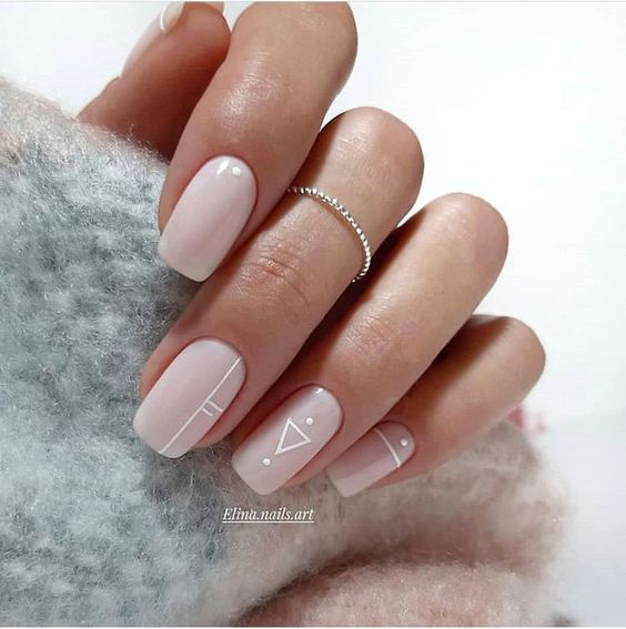 icy pink nails with white boho patterns are amazing for a modern boho bride and look very stylish