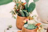 large wicker pots with cacti and succulents plus greenery will decorate your wedding venue in a cool way