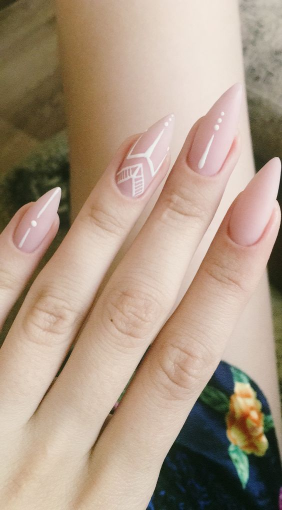 light pink matte wedding nails with white tribal patterns are ideal for a boho bride
