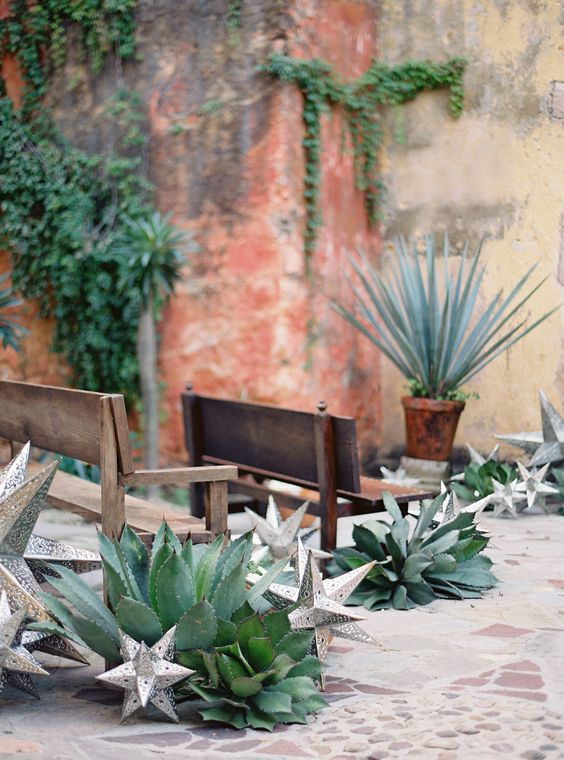 oversized succulents and 3D silver stars will line up your wedding aisle in a dreamy way