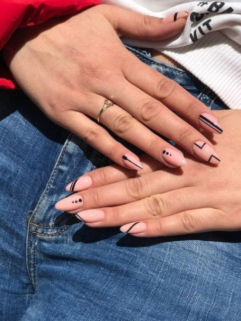 pink nails with black boho patterns are a lovely and cool idea for any boho bride or not only a bride