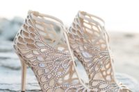 taupe laser cut fully embellished wedding shoes with cutouts and peep toes look very bold and statement