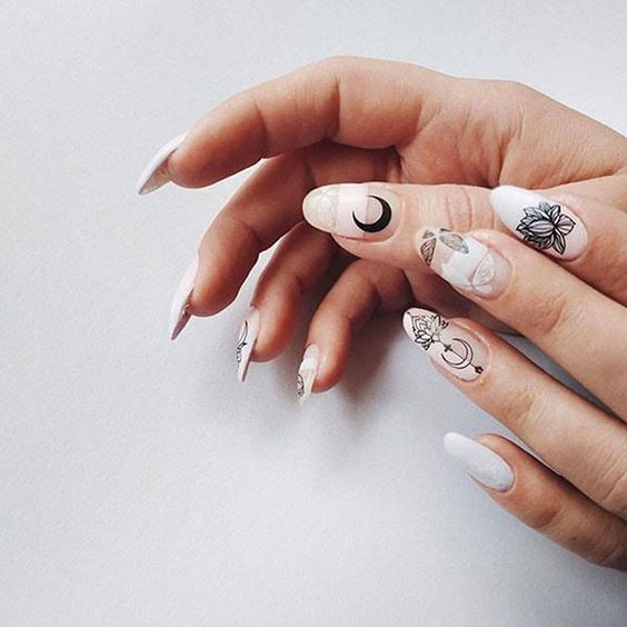 white and nude nails with black boho decals are a cool and bold idea for a boho bride