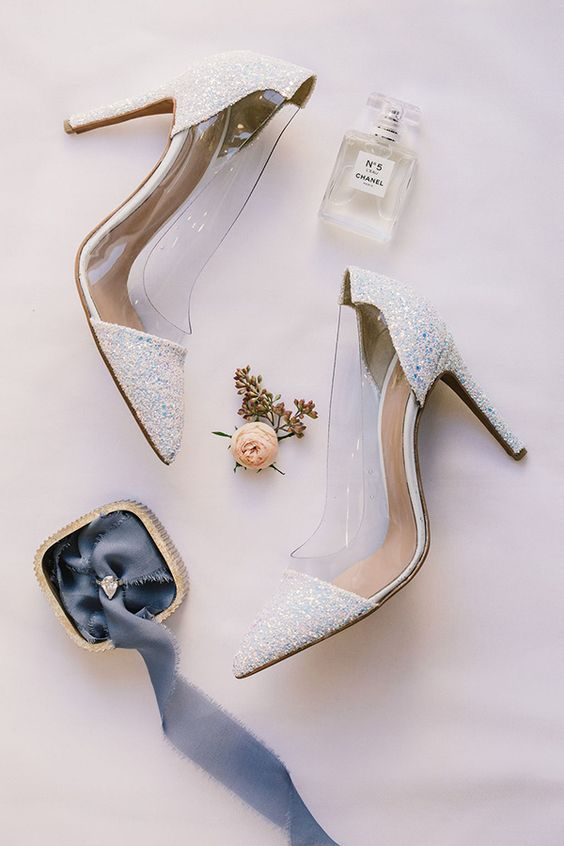 white glitter and sheer acrylic wedding shoes are a trendy solution for a fashion-forward bride