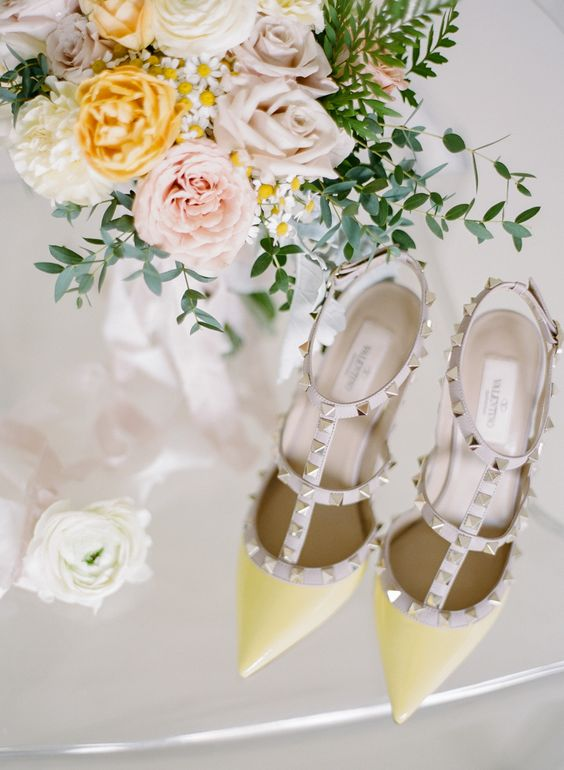 yellow spiked Valentino pointed toe heels for a bold color statement at a spring or summer wedding