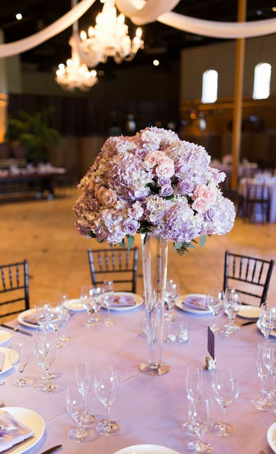 a beautiful lilac and blush wedding centerpiece of blooms looks refined and very chic