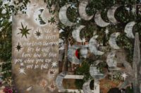 a celestial wedding seating chart with hanging half moons and stars will fit a celestial wedding