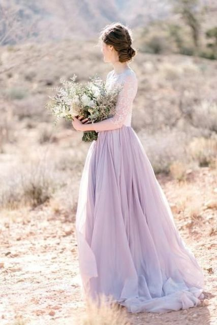 a chic bridal look with a white lace top with short sleeves and a lilac layered skirt will fit a spring or summer wedding