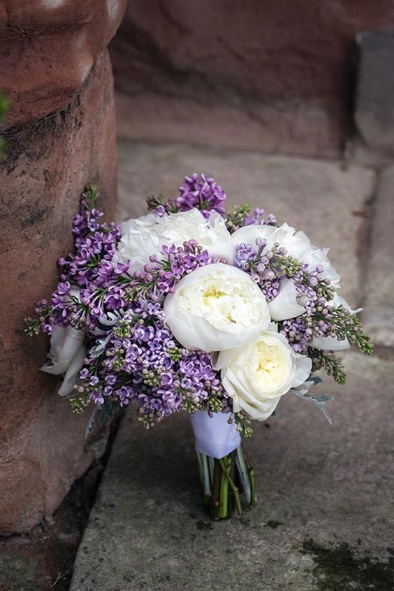 a chic lilac and white peony wedding bouquet with a lilac ribbon is amazing and very beautiful