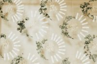 a chic wreath wedding seating chart of wreath froms, eucalyptus and tags is a gorgeous idea