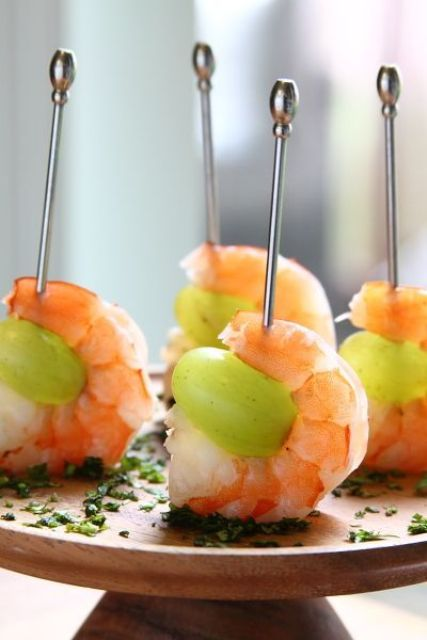 a fresh and delicious combo of a shrimp and grapes plus herbs will be an amazing appetizer for a tropical or beach wedding