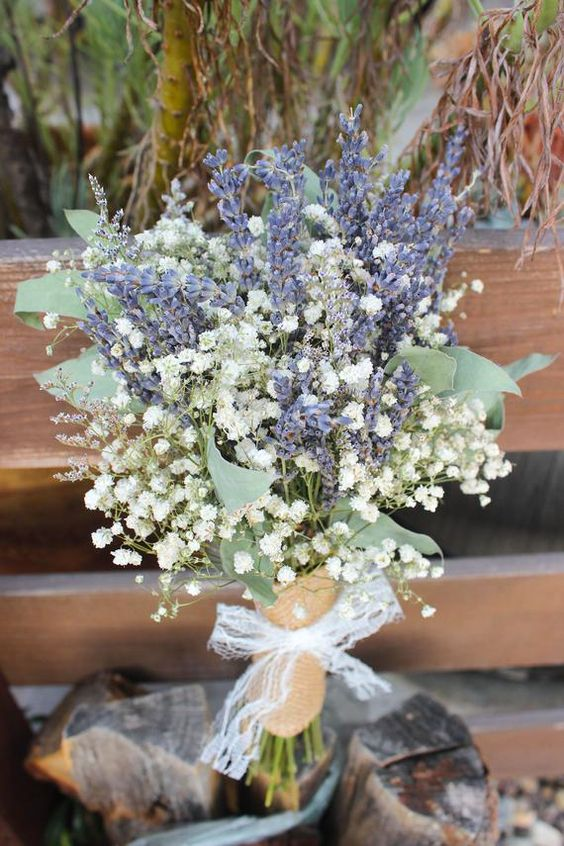 a lavender and baby's breath wedding bouquet with foliage is a chic rustic idea