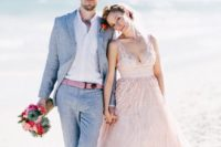 a light grey suit, a white shirt and a pink belt to tie the groom's look to the bridal outfit