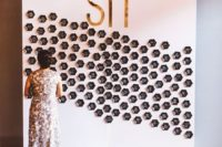 a modern glam seating chart made with shiny black hexagons is a super stylish idea