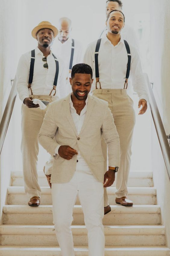 a tan suit, a white shirt and white pants to look chic and stylish on your beach wedding day