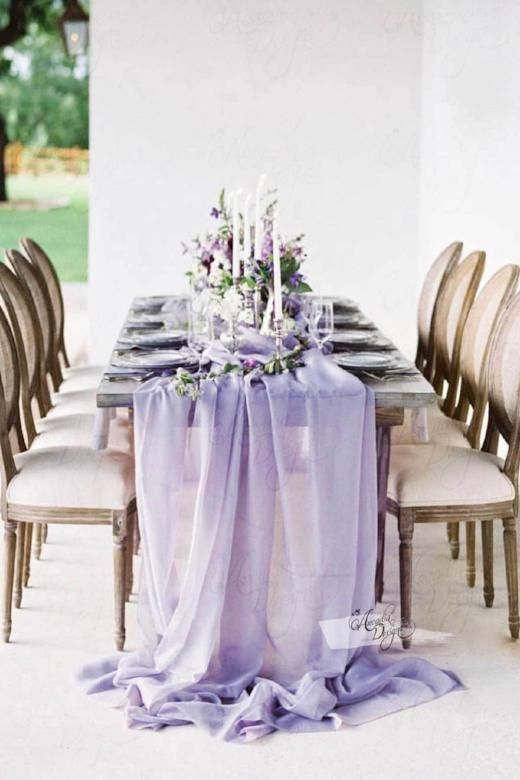 an airy lavender-colored wedding table runner and matching blooms make the tablescape super chic