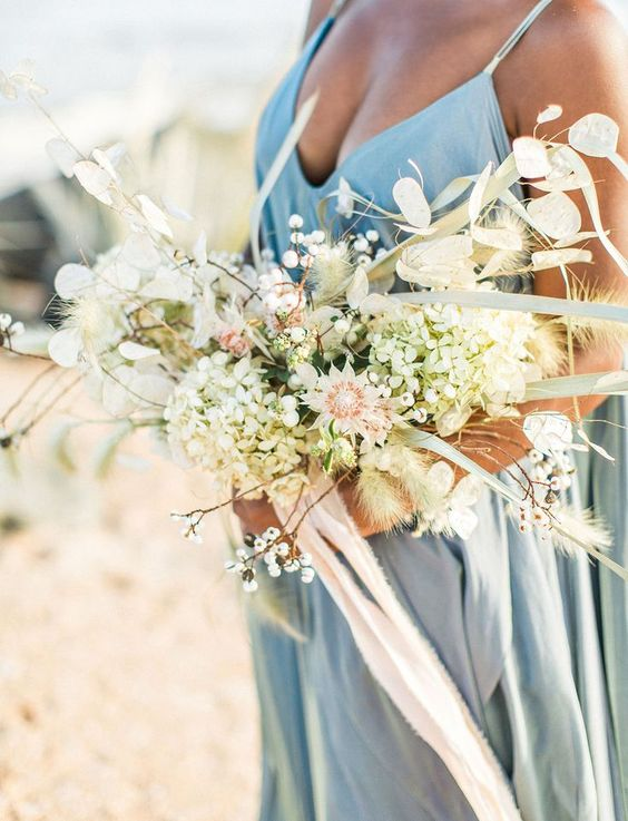 an ethereal and textural wedding bouquet with pastel and neutral blooms and dried touches