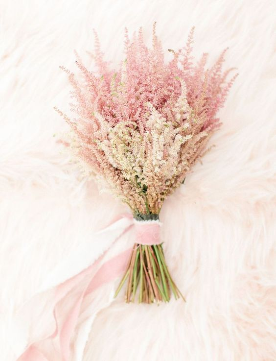 an ethereal pink wedding bouquet with pink ribons is a veyr cute and girlish idea